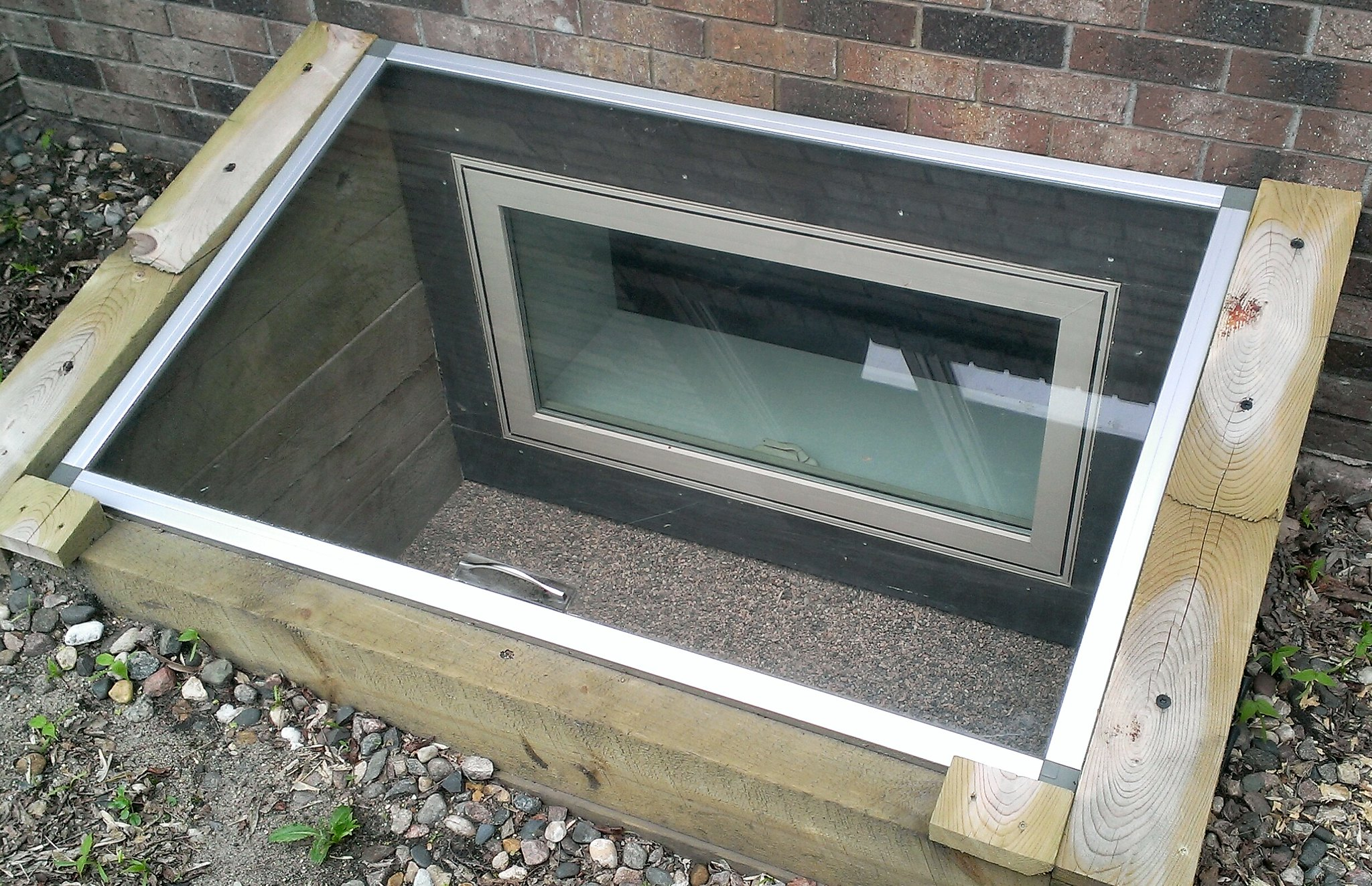 a wall well egress built by a home waterproofing company Northern VA